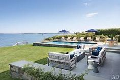 Frank Greenwald's Sag Harbor home is featured in Architectural Digest this month. This outdoor pool and patio area is absolutely perfect! Used to live in the Northwest woods area and bike to the sound that was deserted and no homes! Outdoor Rooms, Outdoor Living, Outdoor Lounge, Outdoor Seating, Urban Deco, Die Hamptons, Cabana, Moderne Pools, Pool Furniture
