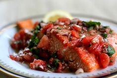 Baked salmon provencal recipe with a sauce of fresh tomatoes, fresh chopped herbs, a few shallots, lemon juice, balsamic and olive oil.
