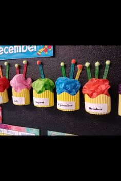 Classroom birthday board idea. Would be cute with their faces on the end of the Popsicle sticks