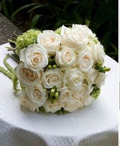 Cream roses and green flowers bridal bouquet