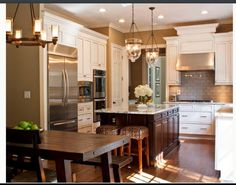 sherwin williams paint color kilim beige. pendants. cabinets. backsplash. i want it all