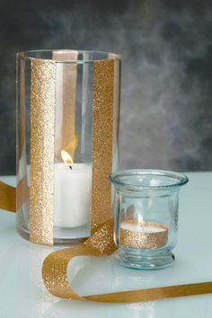 Gold glitter ribbon as a cheap and super simple way to add sparkle to plain cylinder vases or even to tea lights. We just used double-sided tape to adhere the ribbon to glass and metal surfaces. #DIY