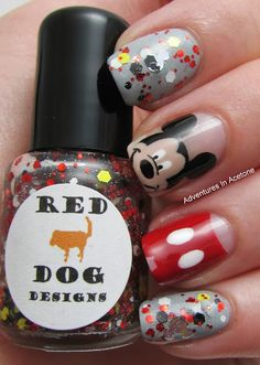 """M-I-C-K-E-Y is """"mouse shaped silver holo glitters, mixed with various sized hex glitters in red, black,  white, and yellow, sprinked with micro holo glitter in a clear base."""" Shown over Sinful Coors Cool Gray base."""