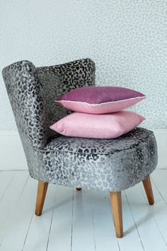 Clarke and Clarke - Floribunda Fabric Collection - A chunky, retro chair upholstered in textured leopard skin fabric in a clean white room with pink cushions Sofa Upholstery, Soft Furnishings, Fabric Tiles, Pink Cushions, Chair Upholstery, Retro Chair, Velvet Interiors, Upholstery, Upholstered Chairs