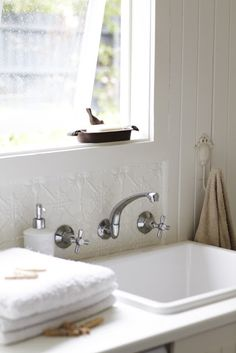 Let's bring back pressed metal tin. Well, I'm not sure it ever left, but I love seeing this product pop up in the interior design world. In the last house I built we did a pressed metal tin splash-back. Tin Tile Backsplash, Tin Tiles, Tin Ceiling Tiles, Pressed Tin, Laundry In Bathroom, Washroom, Splashback, Bathroom Renovations, Bathroom Ideas