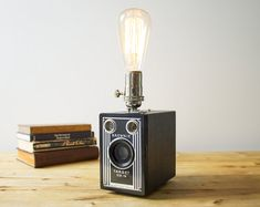 whoa Kodak Brownie camera lamp by SpeakeasyLamps! I loved learning about these old box cameras in class Box Brownie Camera, Box Camera, Antique Lighting, Industrial Lighting, Homemade Lighting, Edison Lamp, Video Game Rooms, Desk Lamp, Lamp Table