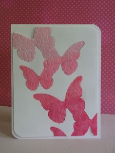 Butterfly die removed and embossed with peony stencil, colored and replaced.
