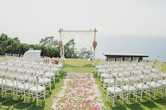 Ceremony on a pruned lawn overlooking the Andaman sea | John and Sher's Magical Wedding at Paresa Resort, Phuket