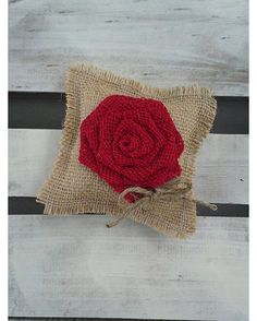 """This """"mini"""" natural burlap ring bearer pillow is detailed with a large red rosette and complete with jute twine for the rings. Perfect for the little guy in your wedding ceremony! #burlap #weddings"""