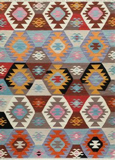 Material: Hand Woven 100% Wool Bright fun colors give a modern twist to the traditional kilim patterns. Hand Woven in India of 100% Wool, these rugs are reversible and durable. Sku: CAR-2 Color: MULTI