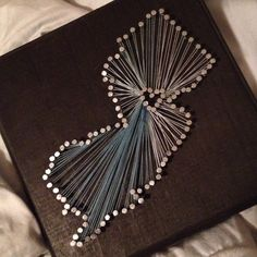 Finally made one! New Jersey state outline nail and string art. I want this so badly...