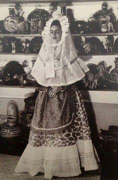 Black and white photo of Frida Kahlo.