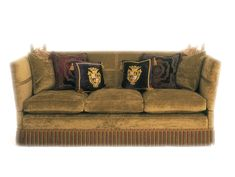Green Velvet covered Knole Sofa with contrasting cushions and accessories