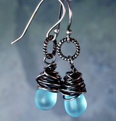 Just in time for those spring showers! Frosted blue glass drops wrapped in oxidized sterling silver. $31