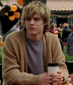 Evan Peters! I do love a man in a cardigan...