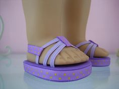 Summer sandals.     Easily slip on with a back strap to keep them on until you take them off. You will receive one pair of sandals like the