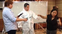 How to Wear the Ebola Personal Protective Equipment