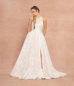 Style 62000 Suki Hayley Paige bridal gown - Ivory Umami embroidered A-line gown, jewel neckline with sweetheart corset lining and contoured cut out back, allover ivory embroidery over cashmere lining, A-line skirt with slit. Shown with matching Umami veil.