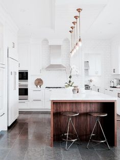 White kitchen with wooden island (via Style at Home). Home Interior, Interior Design Kitchen, Interior Decorating, Decorating Ideas, Kitchen Designs, Interior Modern, Stylish Interior, Decorating Websites, Sweet Home