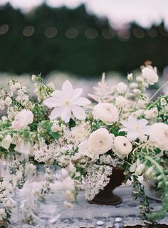 Gorgeous and romantic white floral arrangement | Elegant White Utah Wedding via oncewed.com