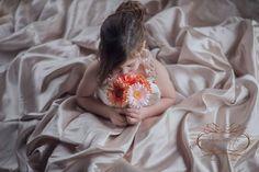 Little girl in mommy's weddingdress, natural light photography, fine art