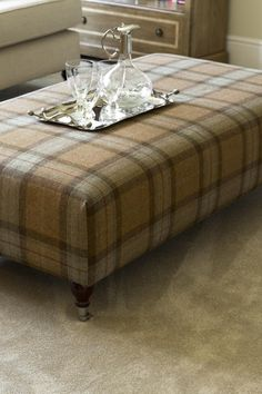This beautiful tartan footstool/coffee table is a great talking point can will really bring a living room together. #livingroom #footstool #tartan