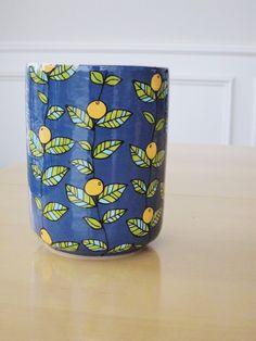 Orange Blossom Vase/Utensil Holder. $30.00, via Etsy.