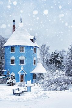 Blue house against a blue sky and white snow.