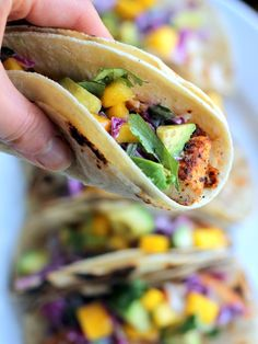 A delicious chili-lime fish taco with a sour cream slaw, sweet mango, and avocado. The perfect Summer meal!