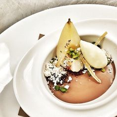 Smoked chocolate panna cotta with poached pear, pistachio, honey powder, cocoa nib, & candied ginger ice-cream.