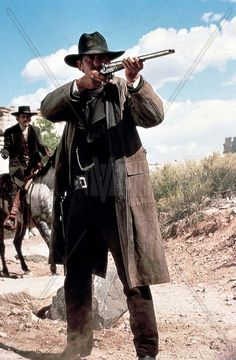 WYATT EARP - Wyatt Earp (Kevin Costner) aims shotgun at outlaw that killed his brother - Directed by Kevin Costner - Warner Bros. Action Pose Reference, Action Poses, Wyatt Earp Kevin Costner, Wyat Earp, Westerns, Old Western Movies, Isabella Rossellini, Western Comics, War Comics