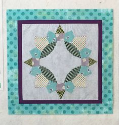 Brimfield Block by Linda Frick... love how color choices make parts look like a bow