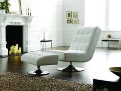 Add a touch of modern chic to your home with our fabulous Marino Swivel Chair and Footstool in Softgrain White | http://www.sofasofa.co.uk/marino/marino-leather-swivel-chair.html