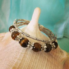 Tibetan Silver & Tiger Eye Bangle $12  Postage $8 To order, message us on our Facebook page Moonsong Jewellery, or email us at moonsongjewellery@gmail.com