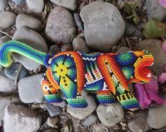 Mexican jewelry, huichol necklaces, huichol bracelets by ArtesaniaHUICHOL Polymer Clay Sculptures, Sculpture Clay, Handmade Shop, Etsy Handmade, Handmade Gifts, The Secret World, Jewelry Show, Basic Colors, Bead Art