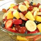 Perfect Summer Fruit Salad Recipe...skipped the banannas and added pomegranite.  Mango would be fantastic in this too! Oh, and next time I would cut the grapes in half so they absorb the dressing too.