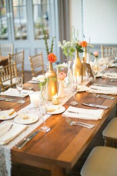 Gold bottles, milk glass bud vases, and lace table runner- love this look! #wedding #lace #reception #decor