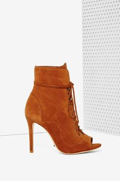 Need a reason to fall for fall? The Akemi Bootie is made in brown suede and features a peep toe, lace-up front, and stiletto heel.