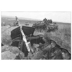 Men of the 2nd SS Panzer Division 'Das Reich' advance with StuG III's during the Battle of Kursk.