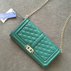 """NWT Rebecca Minkoff Love Clutch Crossbody inJungle NWT Rebecca Minkoff Love Clutch Crossbody in Jungle green. Accents are a very light gold. Includes authenticity card. Approx 11""""W x 6""""H x 1.5""""D. Strap drop: 22.5"""". Rebecca Minkoff Bags Crossbody Bags"""