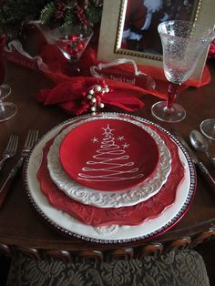 White Christmas tree design on red plate for Christmas dinner or party from Purple Chocolat Home: Santa Claus Is Coming To Town Tablescape.