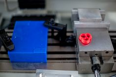 Tormach CNC Mill carves out necklace mold from this blue wax block at GE Garages during #SXSW.