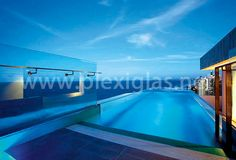 It's late summer in Australia at the moment. Just the right time to jump into a pool, https://www.youtube.com/watch?v=-rTSrvUQ4wI&index=19&list=PL1DC07C1F52E055E2 for example one with walls made of PLEXIGLAS®. Did you know glass makes water look green? PLEXIGLAS®, by contrast, reproduces exactly the same color as the sky it reflects. No winter grayness here, but blue in blue.