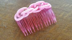 https://www.ebay.com/itm/Vintage-PRETTY-in-PINK-Extruded-CELLULOID-HAIR-COMB-Accessory-Spaghetti-Chain/222907281567?hash=item33e64f309f:g:LZYAAOSwfaBawXuO