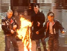 """Punks burning a US flag (early 1980's)"". I need to stop taking pictures from wikipedia but I keep laughing at how awkward these guys look doing their thing"