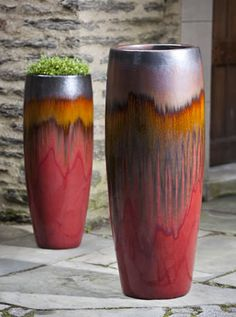 Desert-like colors.  Would love a pair at the base of our porch, to welcome into the home.  Sabine Tall Planter S/1