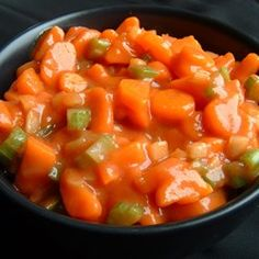 Marinated Carrot Salad Recipe - Tender coins of cooked carrots are tossed with crisp celery, green onions and bell pepper and marinated in a sweet and tangy tomato-based marinade. Spicy Carrots, Pickled Carrots, Cooked Carrots, Recipe For Marinated Carrots, Puffed Wheat Cake, Carrot Salad Recipes, Carrot Coins Recipe, Sauces, Ham Dinner
