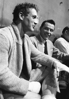 Frank Sinatra (in costume for High Society) visiting Paul Newman on the set of Somebody Up There Likes Me, photographed by Sanford Roth, 1956