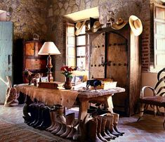 Stone room country rustic boots cow hide rustic farm table