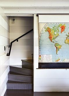 Map Hiding TV | Remodelista In a Marin County, California, beach house, designer Erin Martin covers a flat-screen TV with a vintage school map.